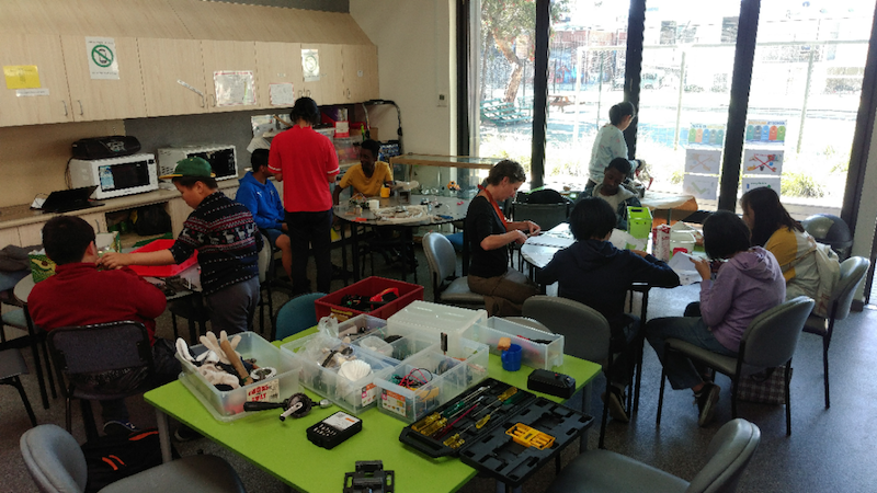 many students attending makerspace and immersed in their activities